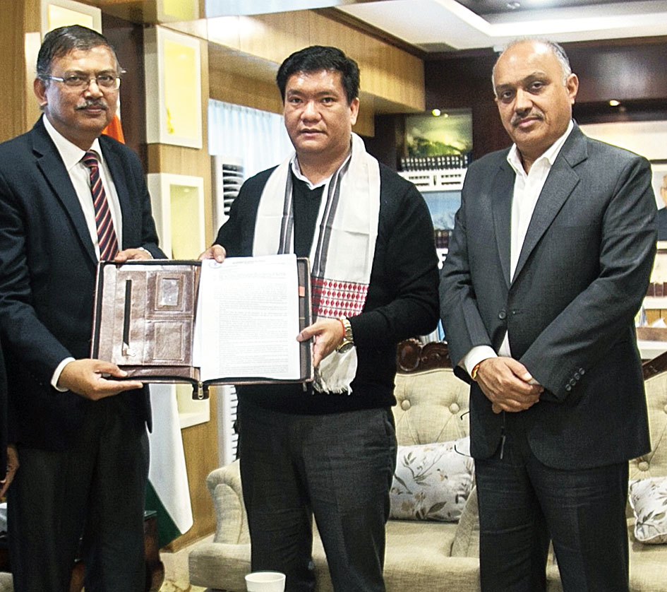 Arunachal Pradesh chief minister Pema Khandu hands over the licences to Inderjit Baruah in Itanagar on Wednesday