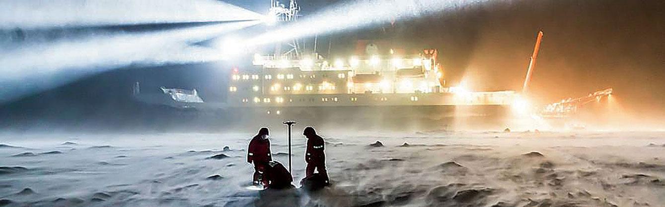 Scientists on Arctic ice beside the RV Polarstern