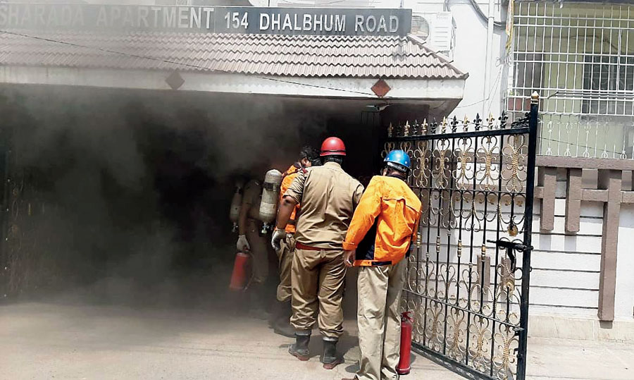 Smoke billows out of the basement of the apartment in Sakchi, Jamshedpur, on Saturday.