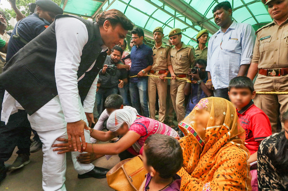 Samajwadi Party President Akhilesh Yadav meets family members of the Unnao rape survivor who were staging a dharna outside KGMC trauma centre in Lucknow, Tuesday, July 30, 2019.