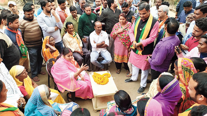 Jharia BJP candidate Ragini Singh (in pink sari) interacts with people
