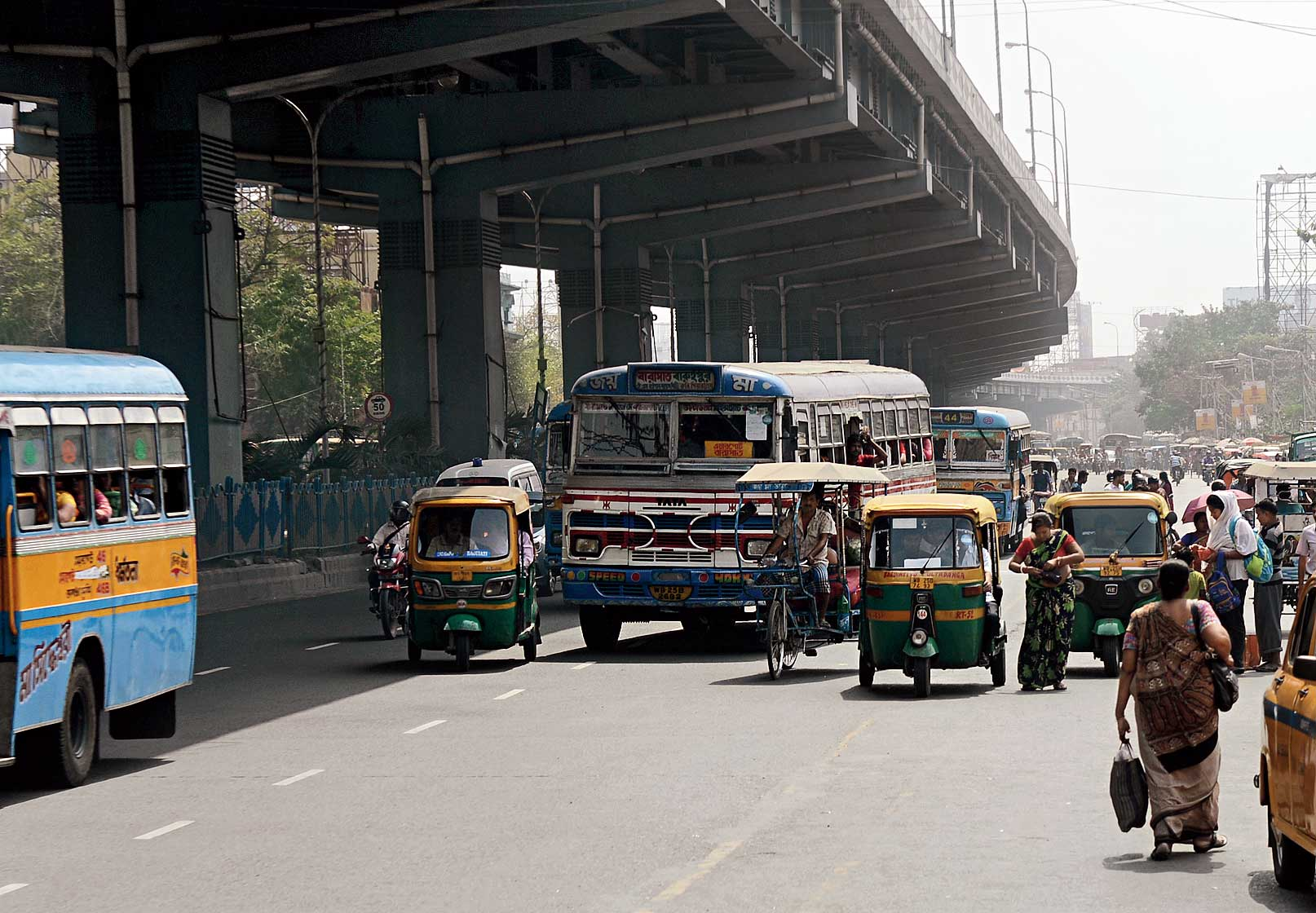 Cars, autos, buses and rickshaws flout traffic rules as they jostle for space on VIP Road. Buses and autos drop off passengers in the middle of the road instead of at designated bus stops. Slow-moving vehicles like autos, rickshaws and cycles are supposed to ply only on the service lane.