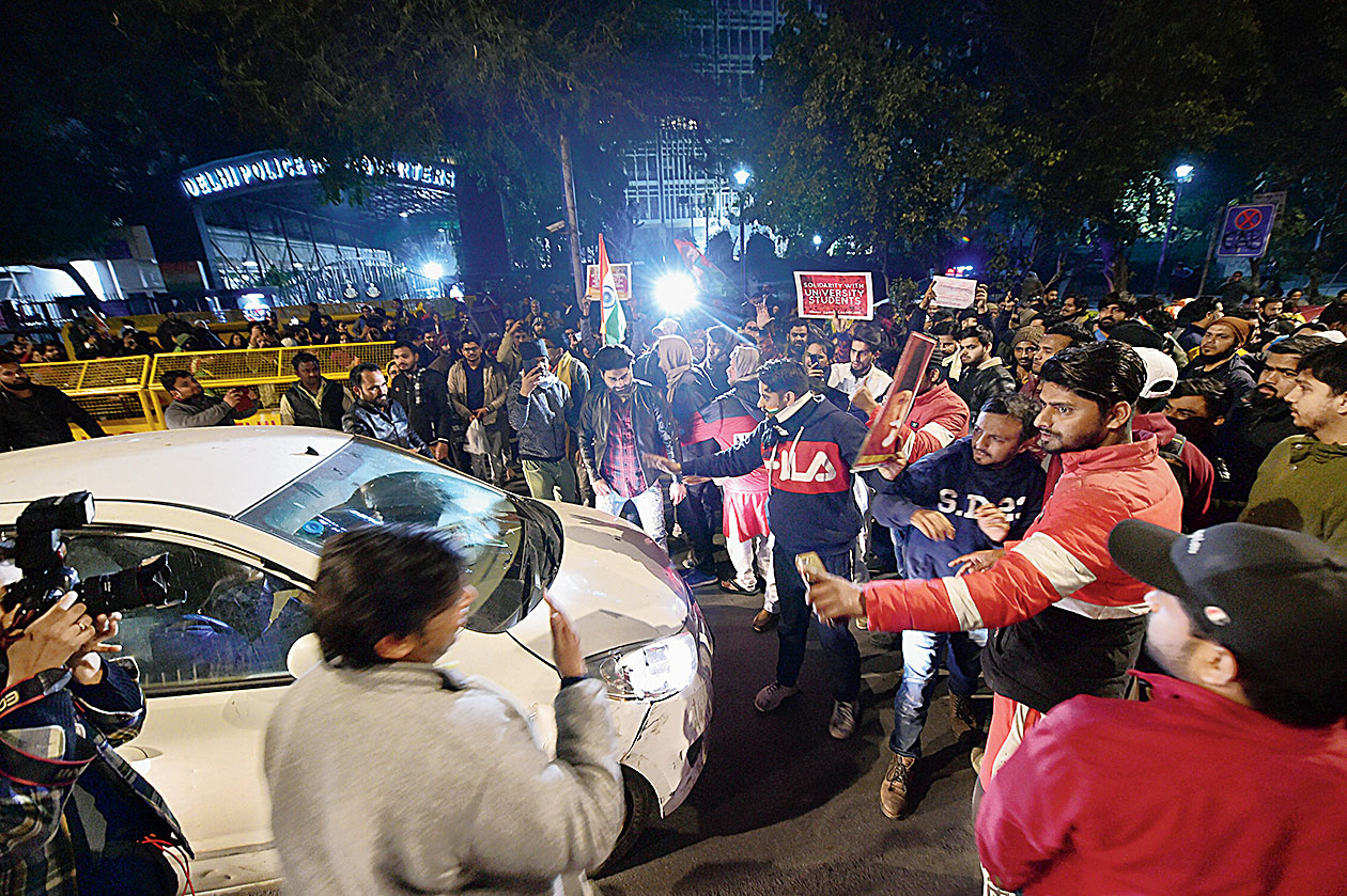 A protest outside the Delhi police headquarters after last month's riots.
