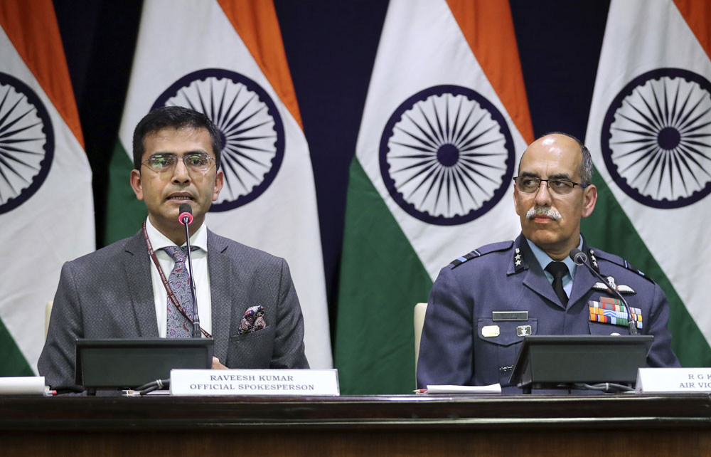 Foreign Ministry spokesperson Raveesh Kumar with Indian Air Force Air Vice Marshal R.G.K. Kapoor gives a statement in New Delhi on Wednesday