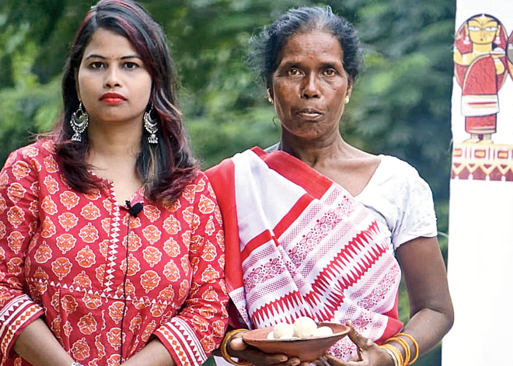 Eat treat: Surabhi Sharma (left) with Nilvis Lakra, a tribal farmer-cum-cook from Ranchi district, during a video shoot for Bhoomi Ka Cuisine channel