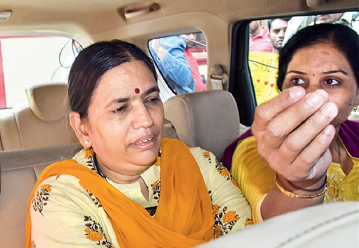 Sudha Bharadwaj being taken from her home in Haryana's Faridabad on Saturday.
