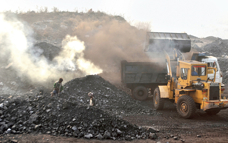 Coal is loaded for transporting at a BCCL loading point in Rajapur, Jharia, on Monday.
