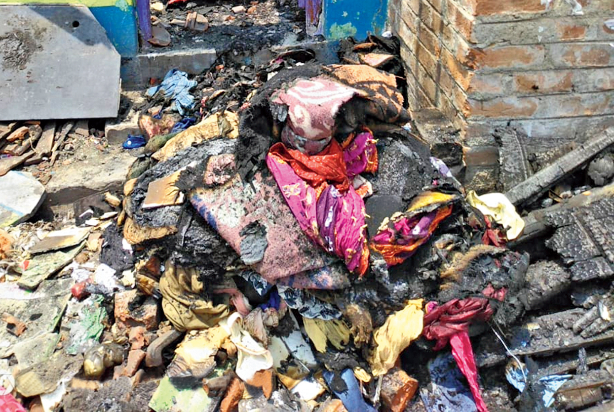 Household and study materials charred in the arson attack on Hena Parvin's home on May 23 in Kankinara.