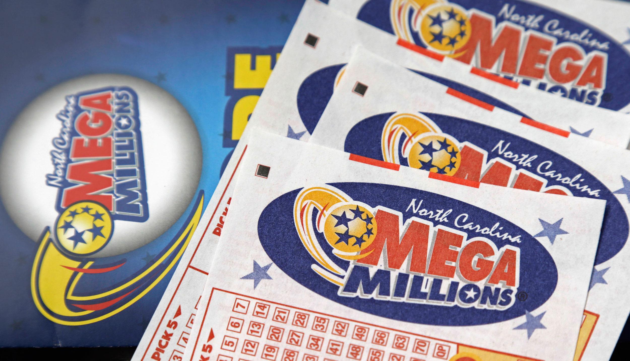Mega Millions lottery tickets rest on a counter at a Pilot travel centre near Burlington, N.C.