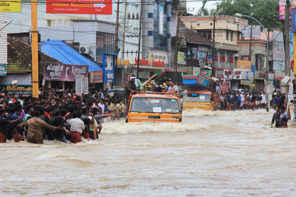 People gather to rescue affected people from a flooded area in Pathanamthitta, Kerala, in August 2018, when the state suffered catastrophic floods. Local administrations should carry out development activities by considering the vulnerability quotient attached to their region