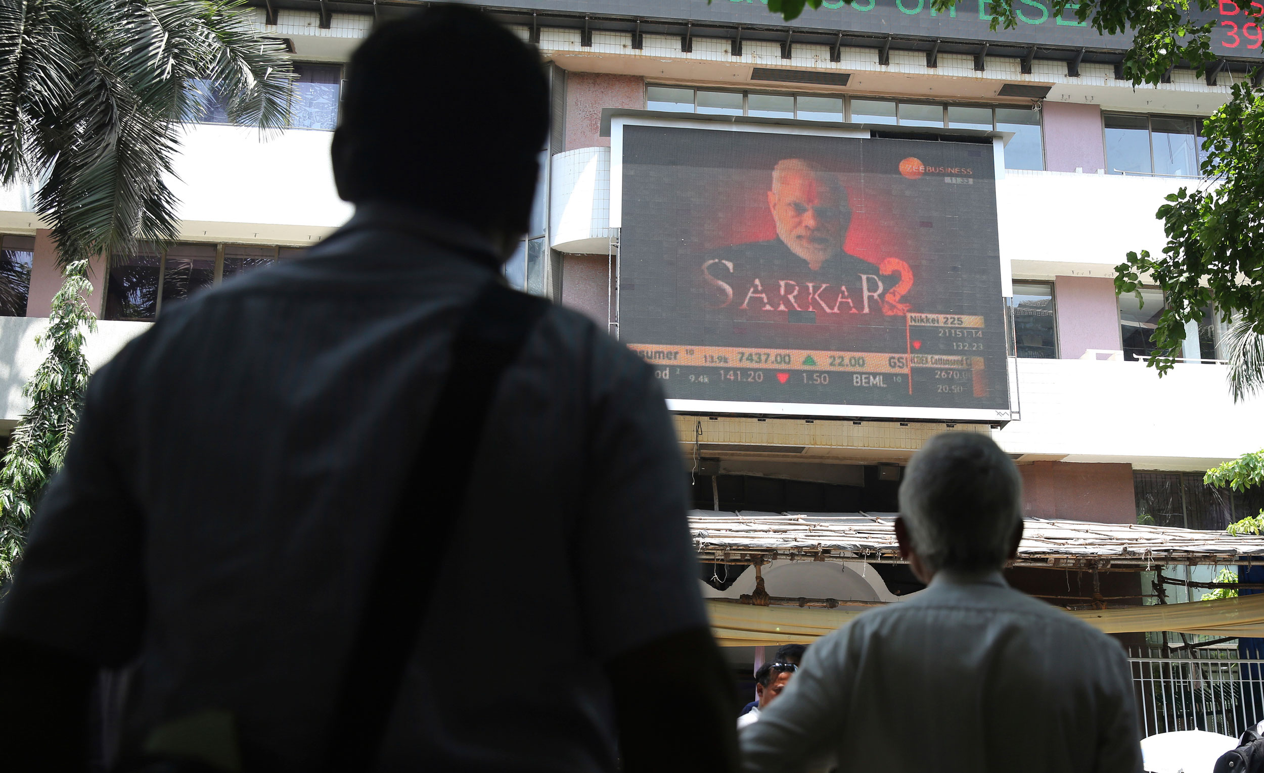 A digital broadcast shows an image of Indian Prime Minister Narendra Modi next to stock prices outside the BSE building in Mumbai, on May 23, 2019.