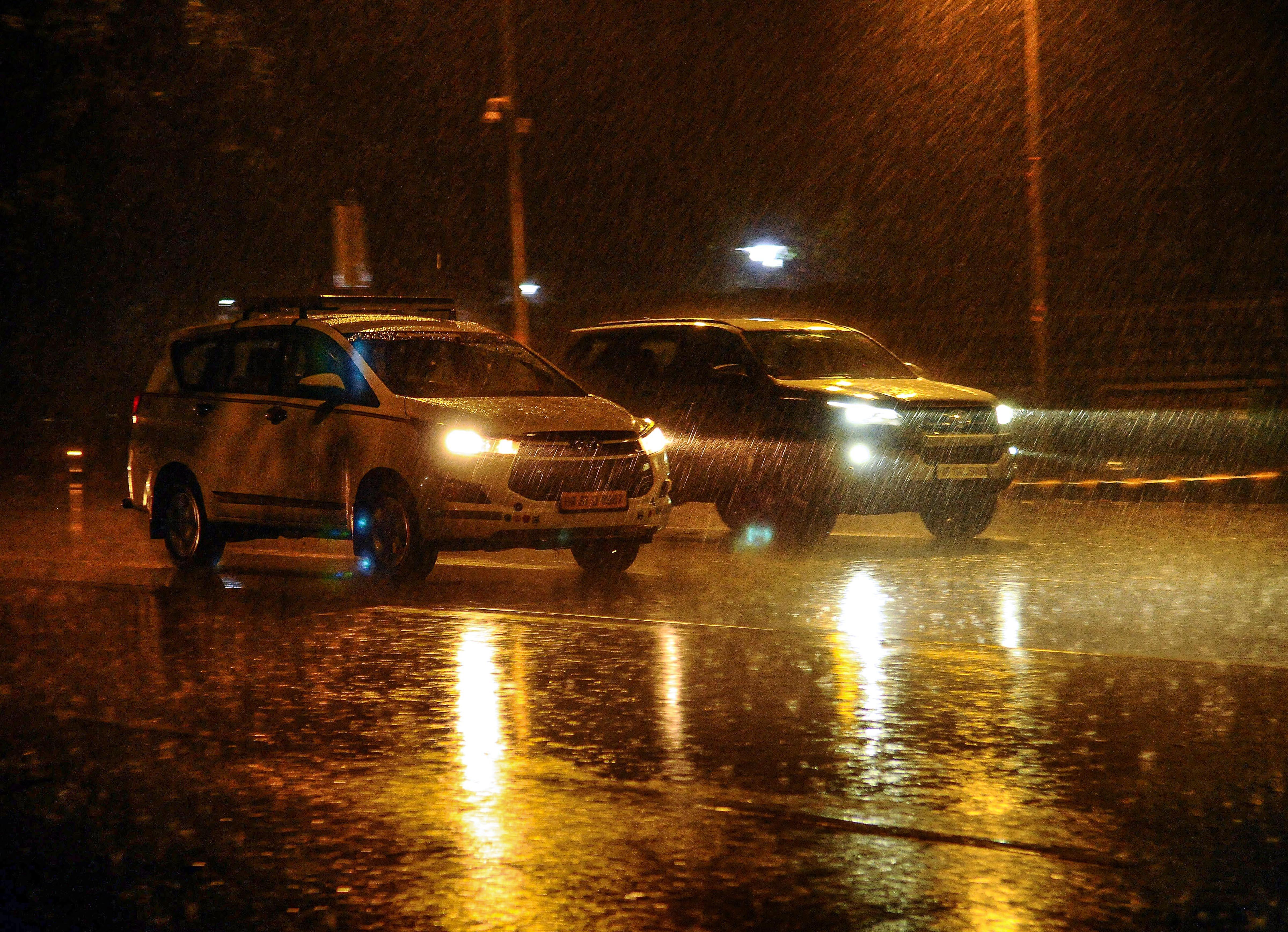 Vehicles ply during rainfall in New Delhi, Thursday, December 12, 2019.