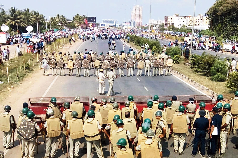 Police personnel resist a farmers' rally at Pahal on Monday.