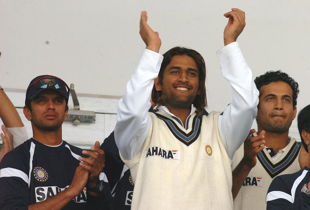 Rahul Dravid, Mahendra Singh Dhoni and Irfan Pathan in the dressing room during the second cricket test match between India and Pakistan at Iqbal Stadium, Faisalabad, in January 2006
