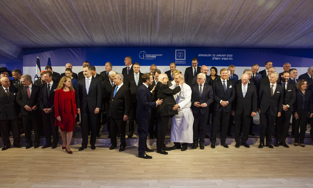 World leaders pose for a group photograph following a dinner reception as Israel's President Reuven Rivlin, center, thanks his chef at his official residence in Jerusalem on Wednesday, January 22, 2020.