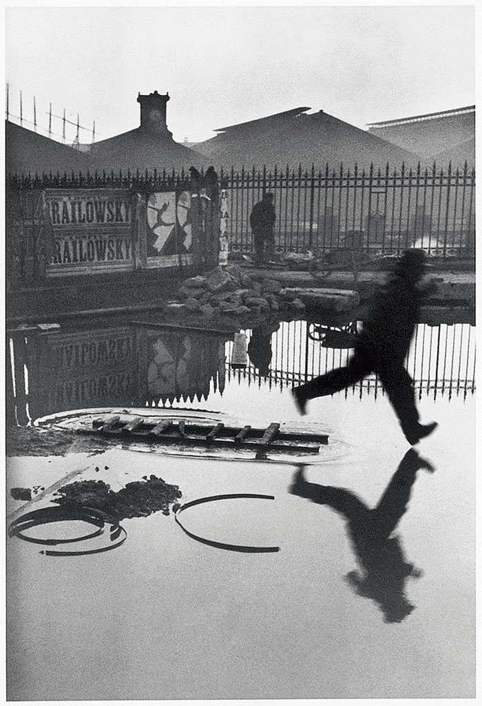 'Behind the Gare Saint-Lazare', a photograph by Henri Cartier-Bresson, is an example of his notion of the 'decisive moment'