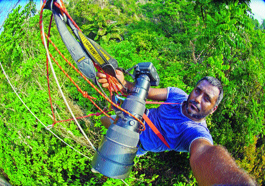 Mukherjee prepares to capture hornbills on Narcondam Island in the Andamans