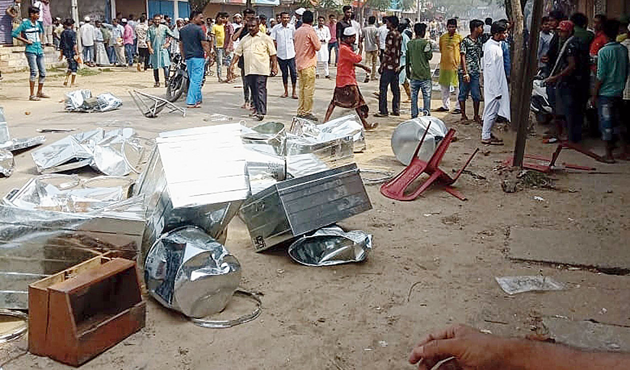 Damaged articles lay strewn as mobs clash in Hailakandi on Friday.