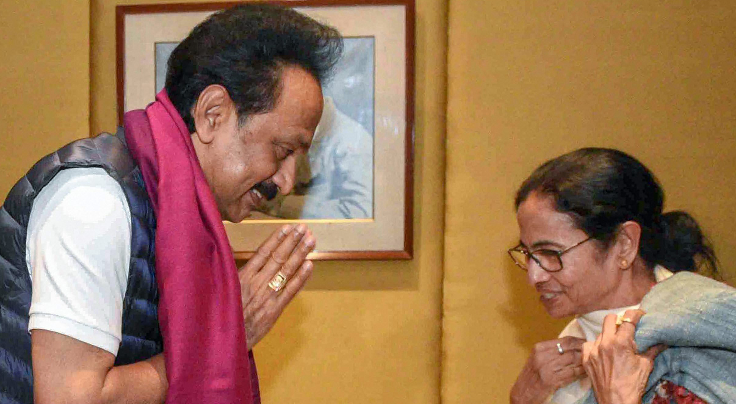 West Bengal Chief Minister Mamata Banerjee exchanges greetings with DMK President M.K. Stalin at a hotel in Calcutta on Friday, January 18, 2019.