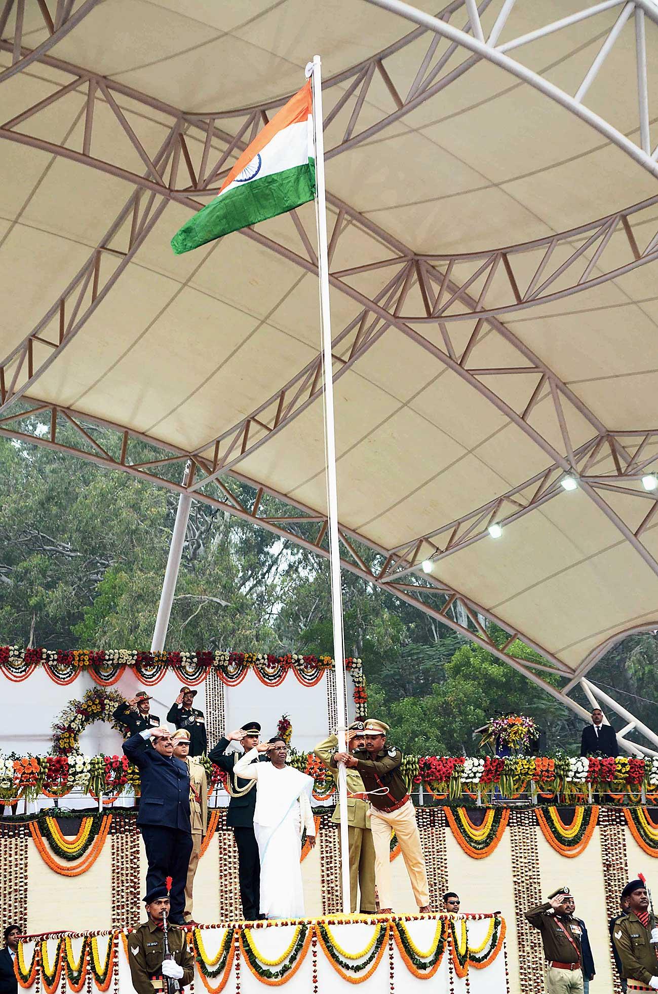Governor Droupadi Murmu, along with chief secretary Sudhir Tripathi and DGP DK Pandey, salutes the Tricolour at Morabadi in Ranchi on Saturday.
