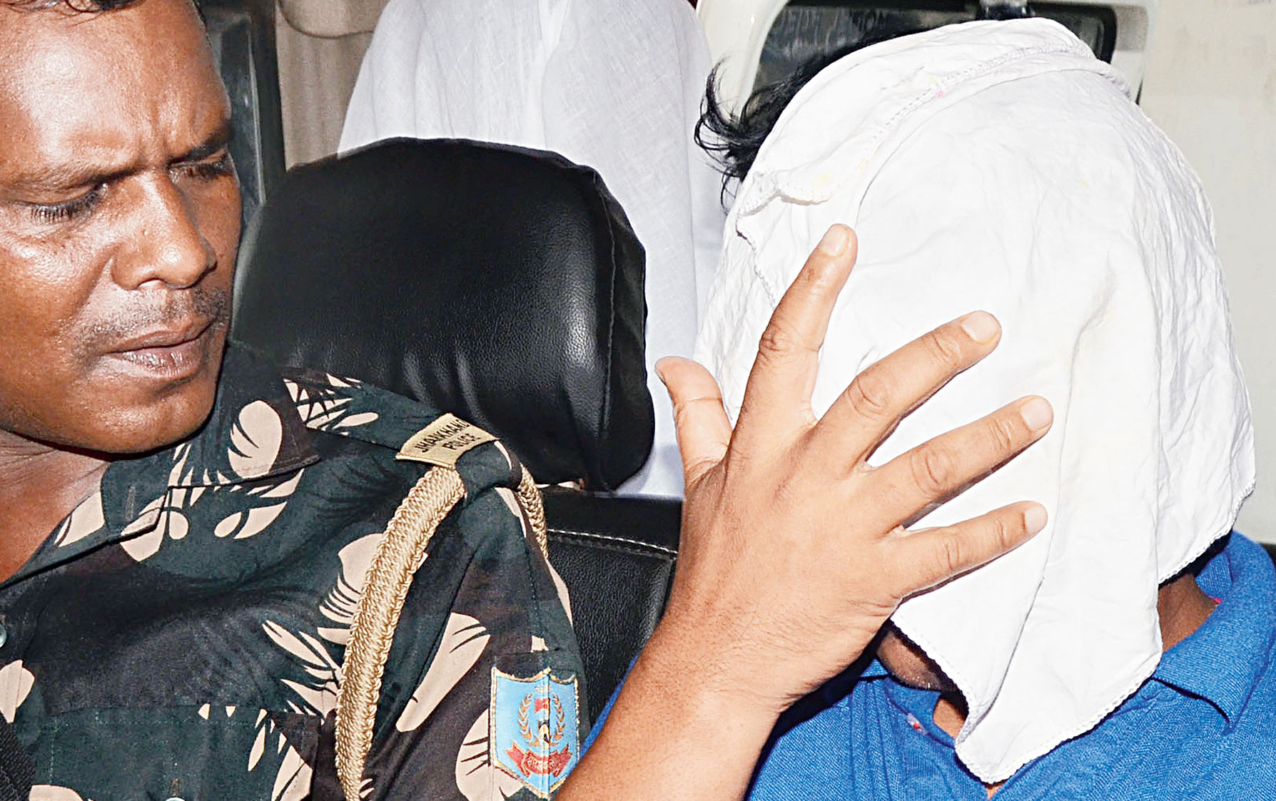 The vice-principal being taken to Dhanbad jail on Tuesday evening.