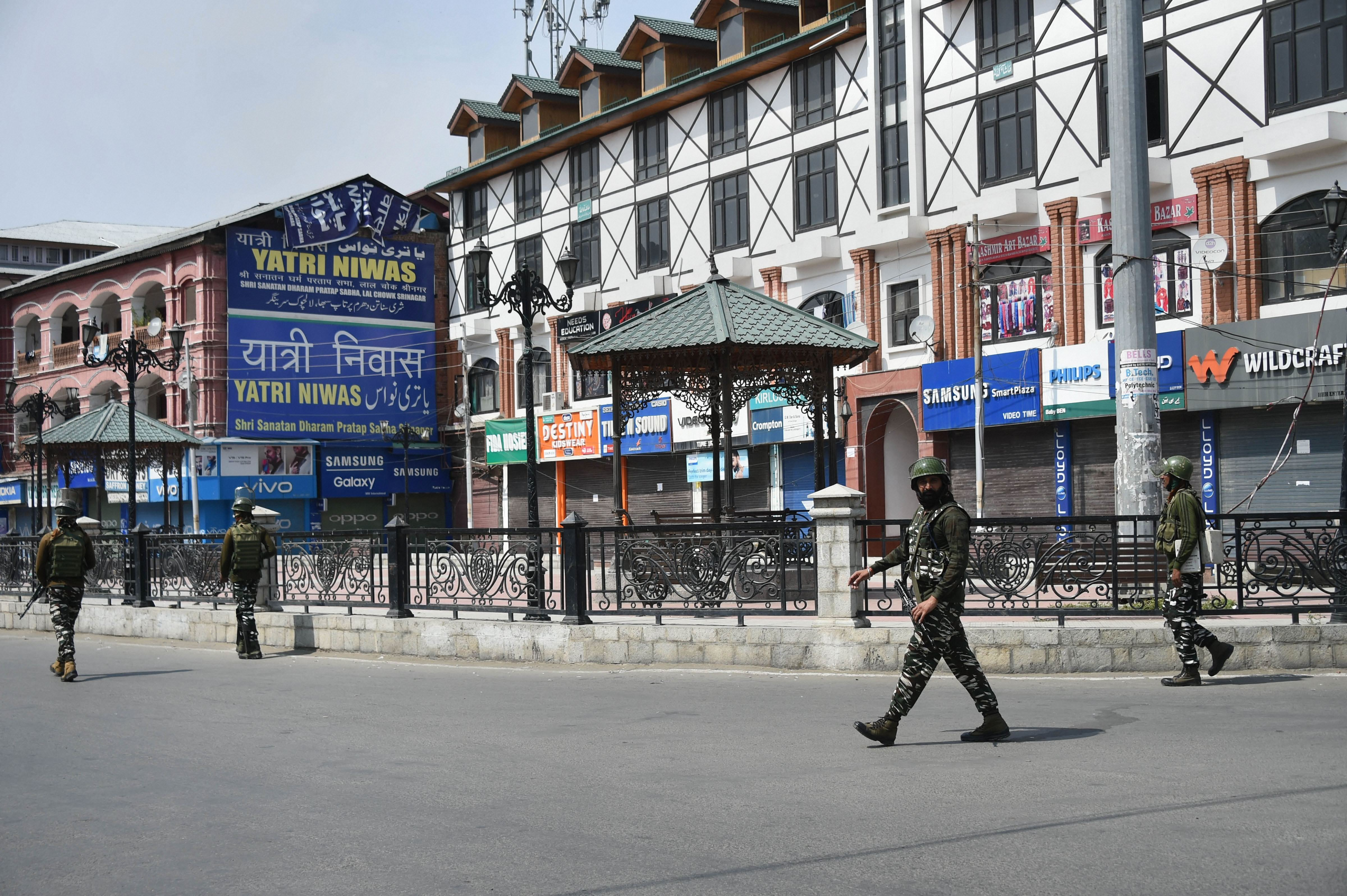 Security personnel patrol a street during restrictions and shutdown, at Lal Chowk in Srinagar on September 20.
