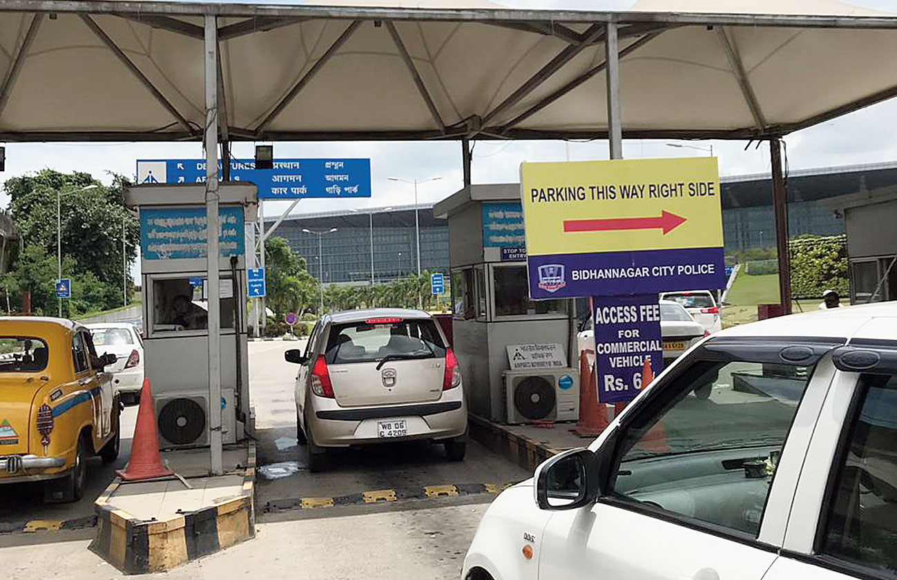 Parking booths back in action at the entrance to the airport on Saturday.