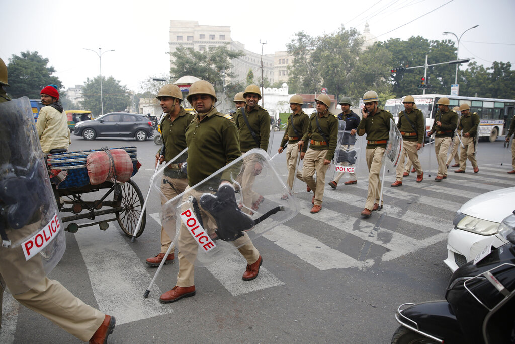 Security personnel patrol a street after violence erupted during an anti-CAA protest in Lucknow.