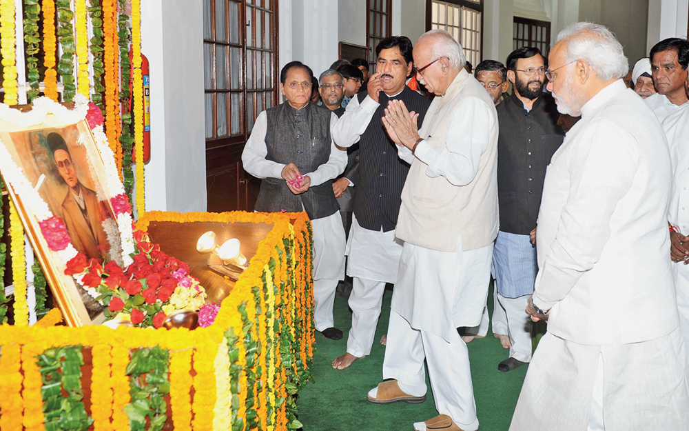 Prime Minister Narendra Modi and senior BJP leader LK Advani pay homage to Vinayak Damodar Savarkar on his birth anniversary at Parliament