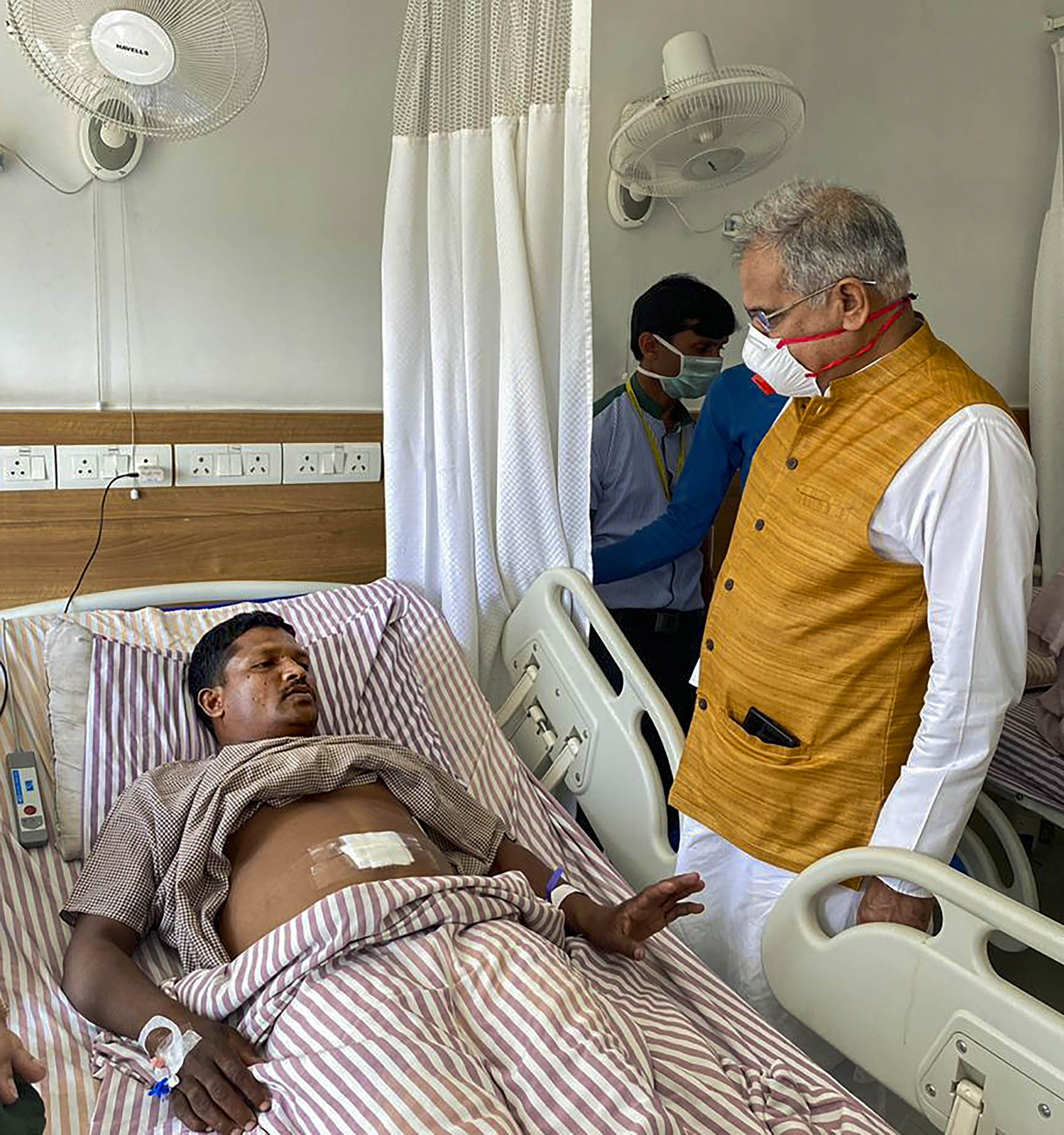 Chhattisgarh chief minister Bhupesh Baghel meets injured police personnel, at Ramkrishna Care Hospital in Raipur, Sunday, March 22, 2020