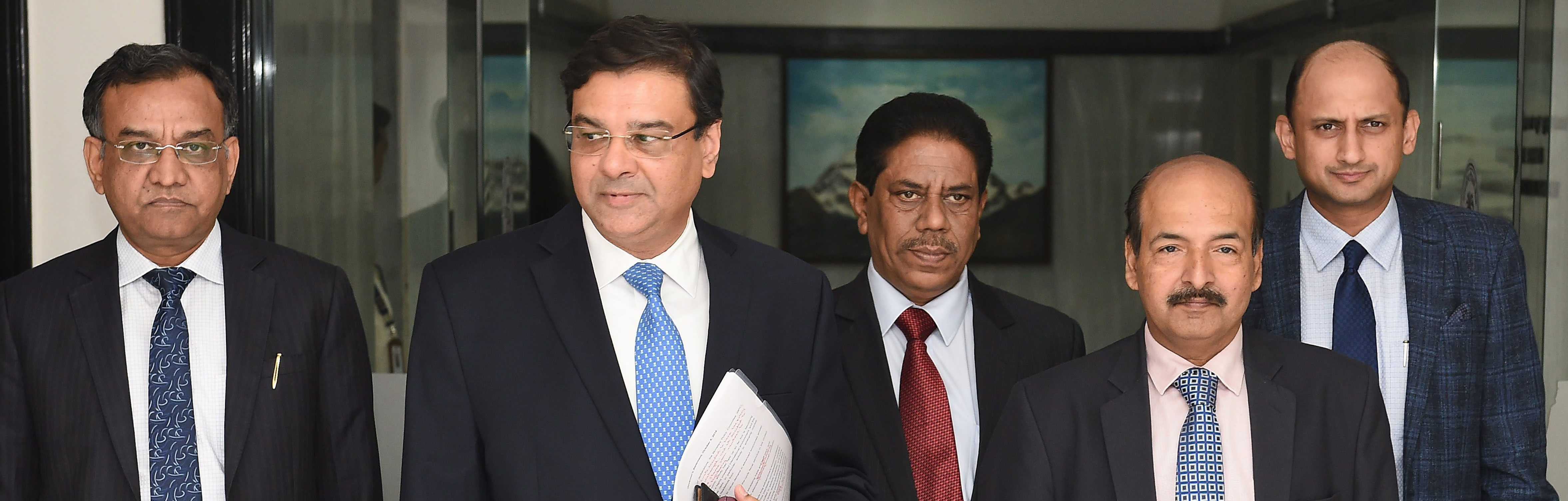 RBI Governor Urjit Patel (left) with deputy governors arrive for a post-monetary policy press conference, in Mumbai on Friday.