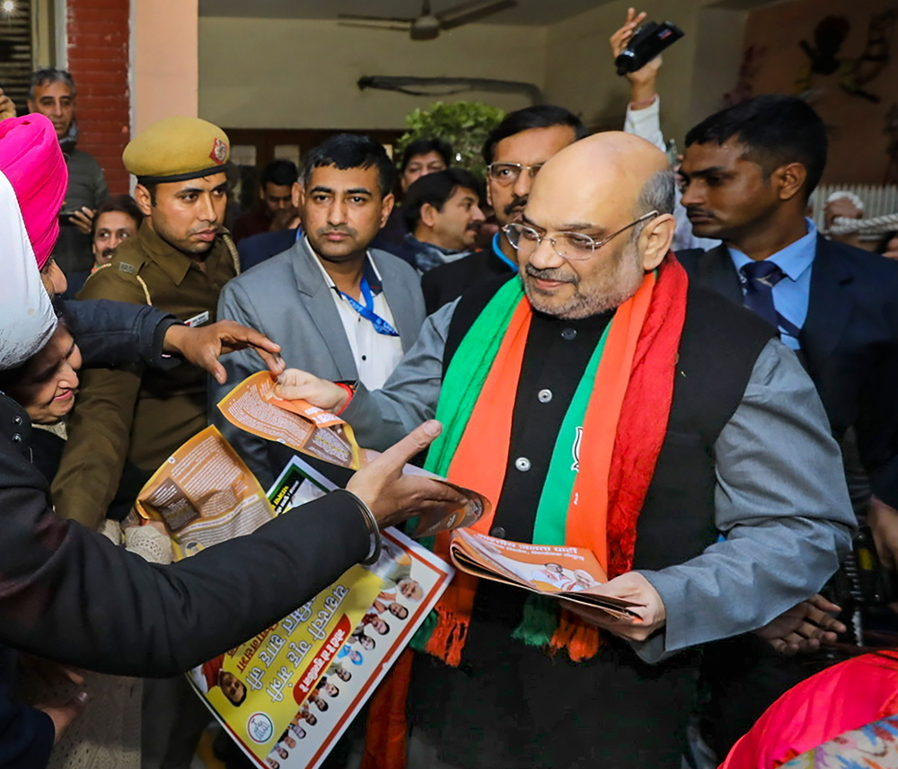 Union Home Minister Amit Shah during door -to-door campaign on CAA at Lajpat Nagar in New Delhi, Sunday, January 5, 2020.