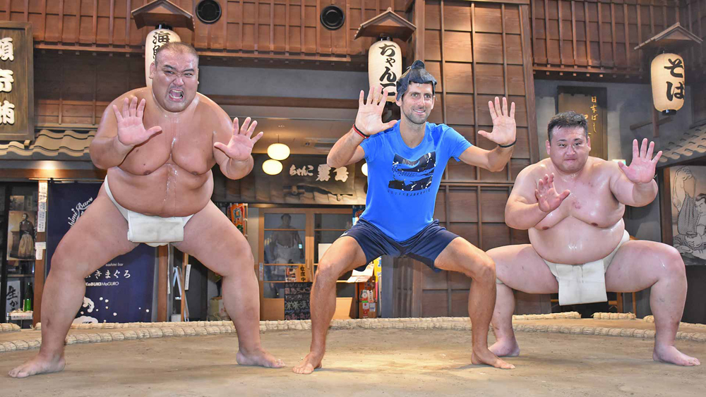 Novak Djokovic at the dohyo with sumo wrestlers on Monday