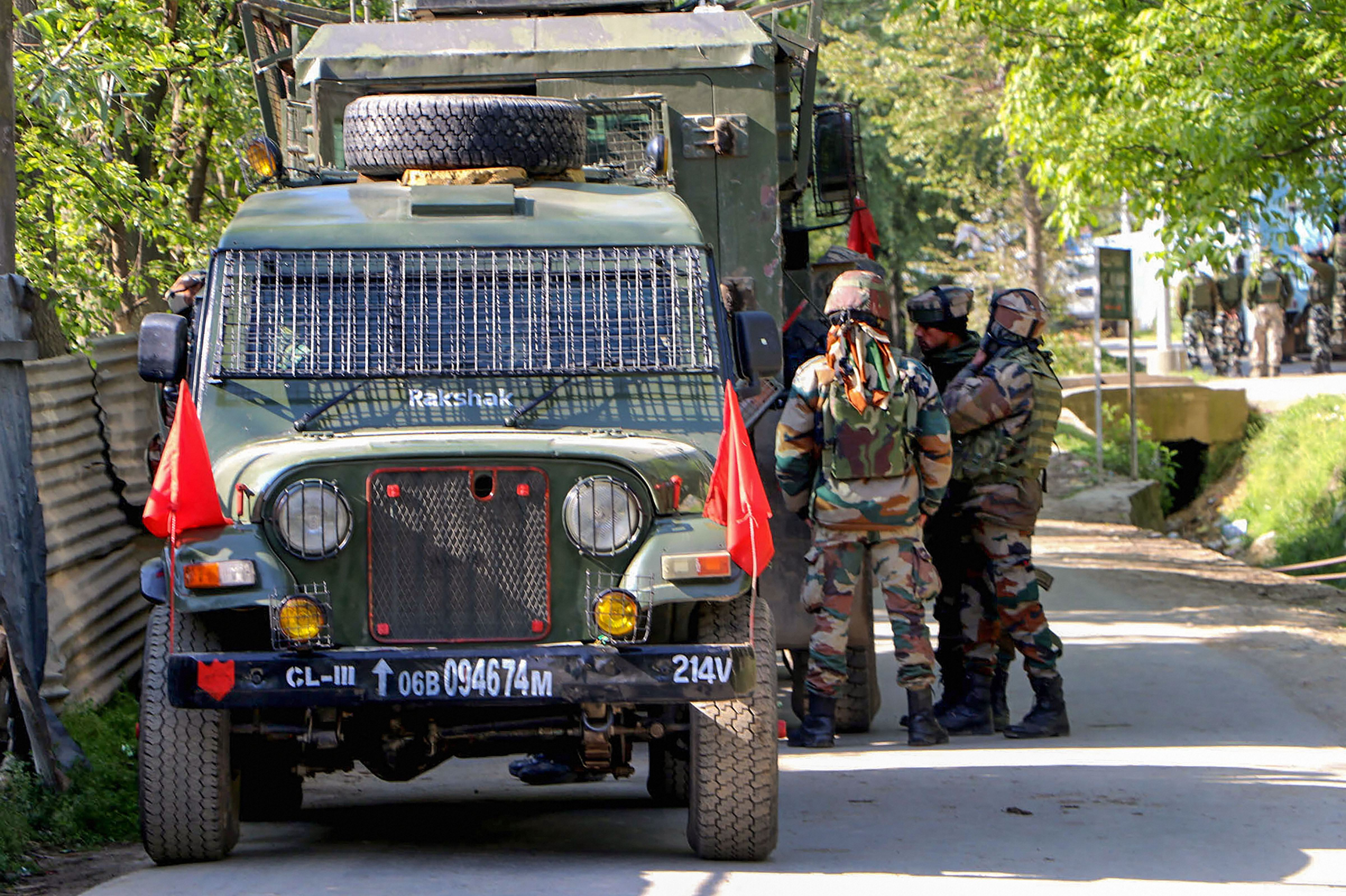 Security forces cordon off the area during an encounter with militants at Melhoora village in Jammu and Kashmirs Shopian district, Wednesday, April 22, 2020. The Hindu correspondent Peerzada Ashiq was booked for his follow up report on Shopian encounter, police said.
