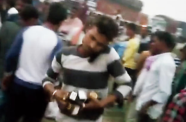 Residents rush off with liquor bottles on Saturday.