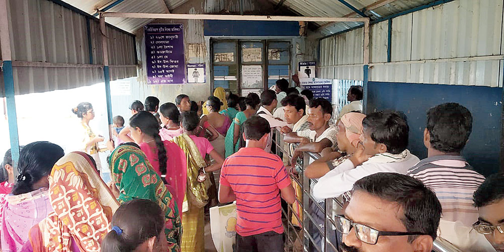 Patients queue up for OPD tickets at Purulia district hospital on Wednesday