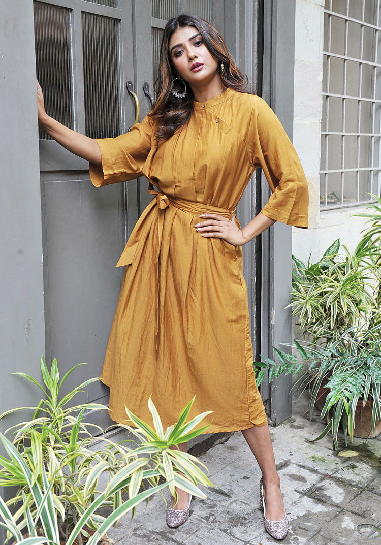 """This belted silk-cotton dress with pleat detailing by The Third Floor Clothing was Parno's pick from the ensembles for auction. """"I love the colour,"""" she said."""