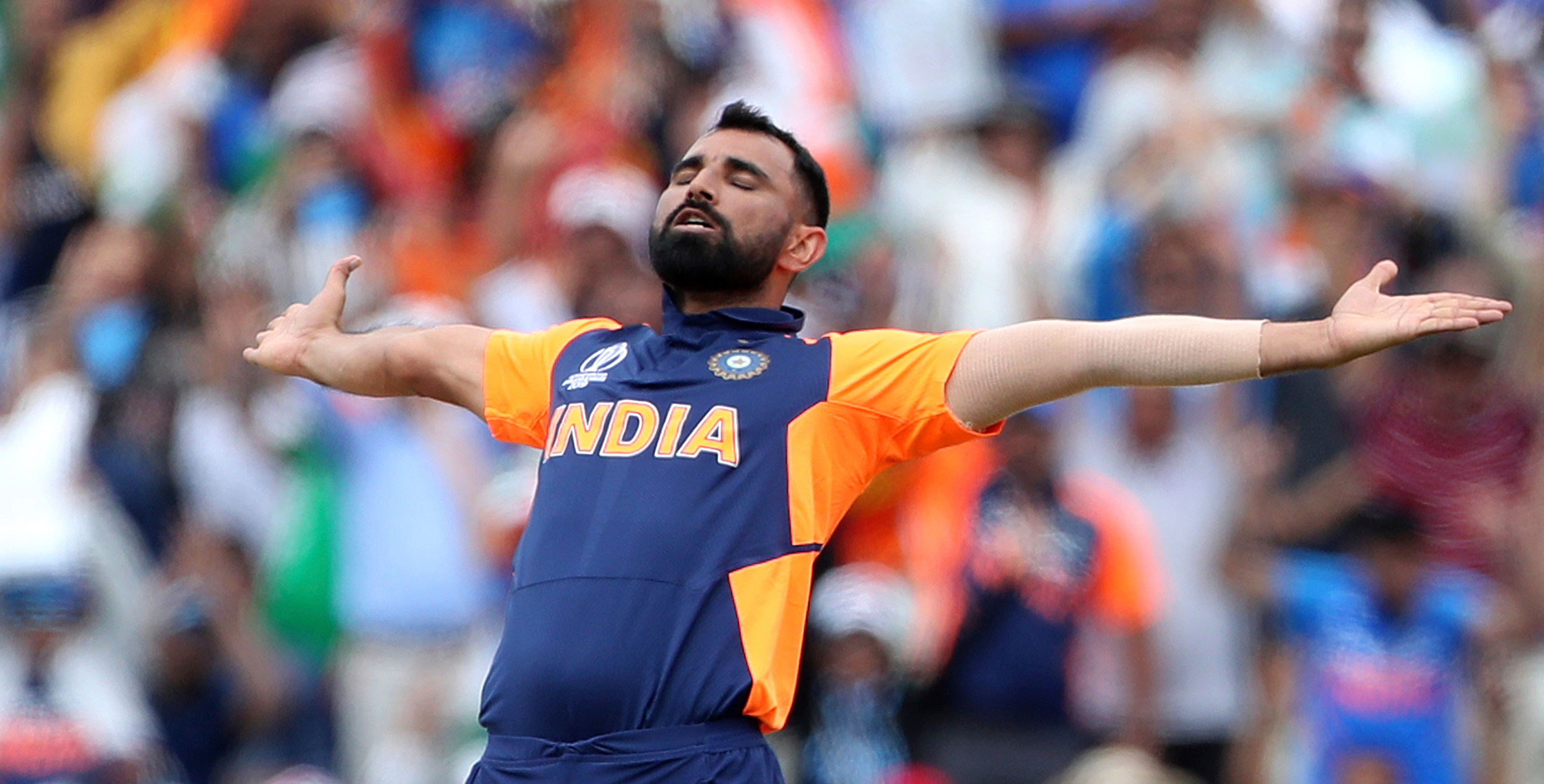 Mohammed Shami celebrates the dismissal of England's captain Eoin Morgan during the ICC Cricket World Cup match between England and India at Edgbaston in Birmingham, England, on June 30, 2019.