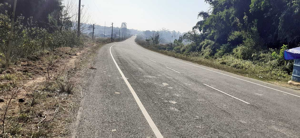A stretch of The Tinsukia Bypass road near Fatikjan.