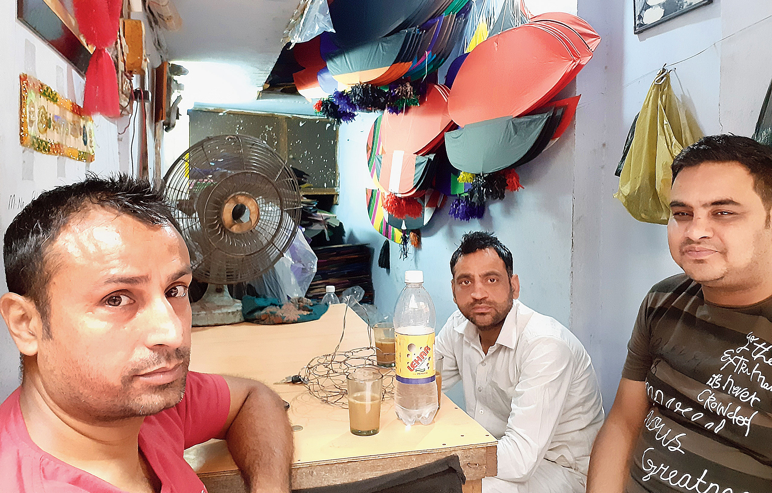 (From left) Kite maker Anil Kapoor, shawl seller Vikram Dhawan and textile trader Vikram Bhatia at Kapoor's shop in Chowk Passian, Amritsar, on Wednesday.