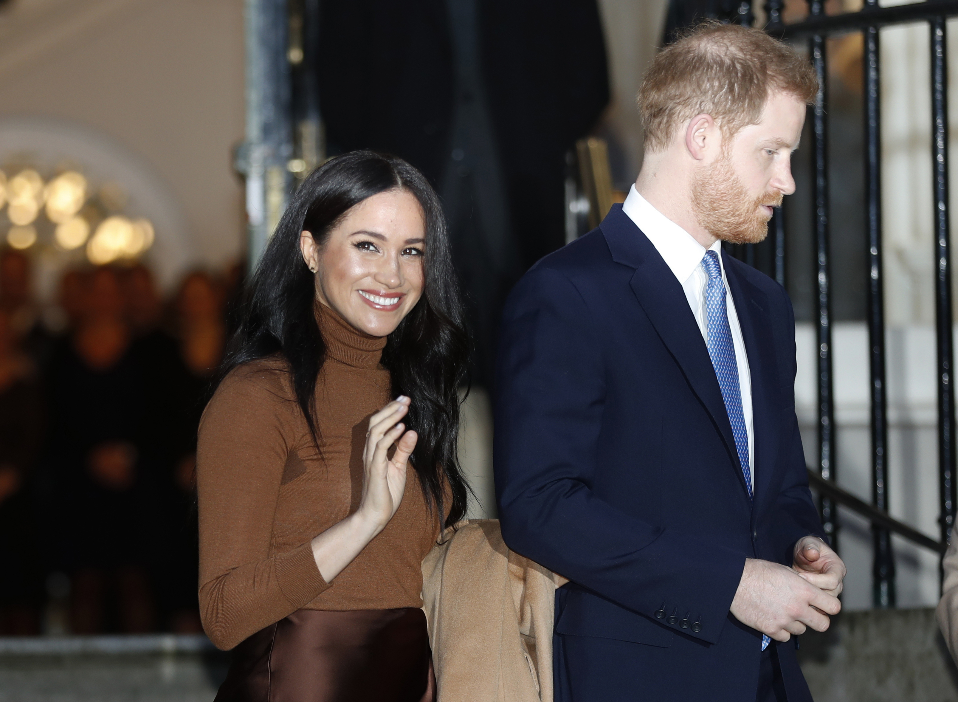 Britain's Prince Harry and Meghan, Duchess of Sussex leave after visiting Canada House in London, after their recent stay in Canada