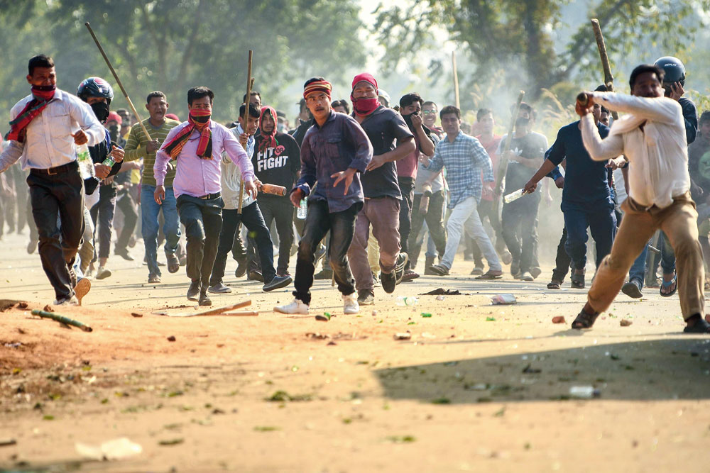 Activists clash with police at Madhav Bari in Tripura on Tuesday during a protest against the passage of the citizenship bill.