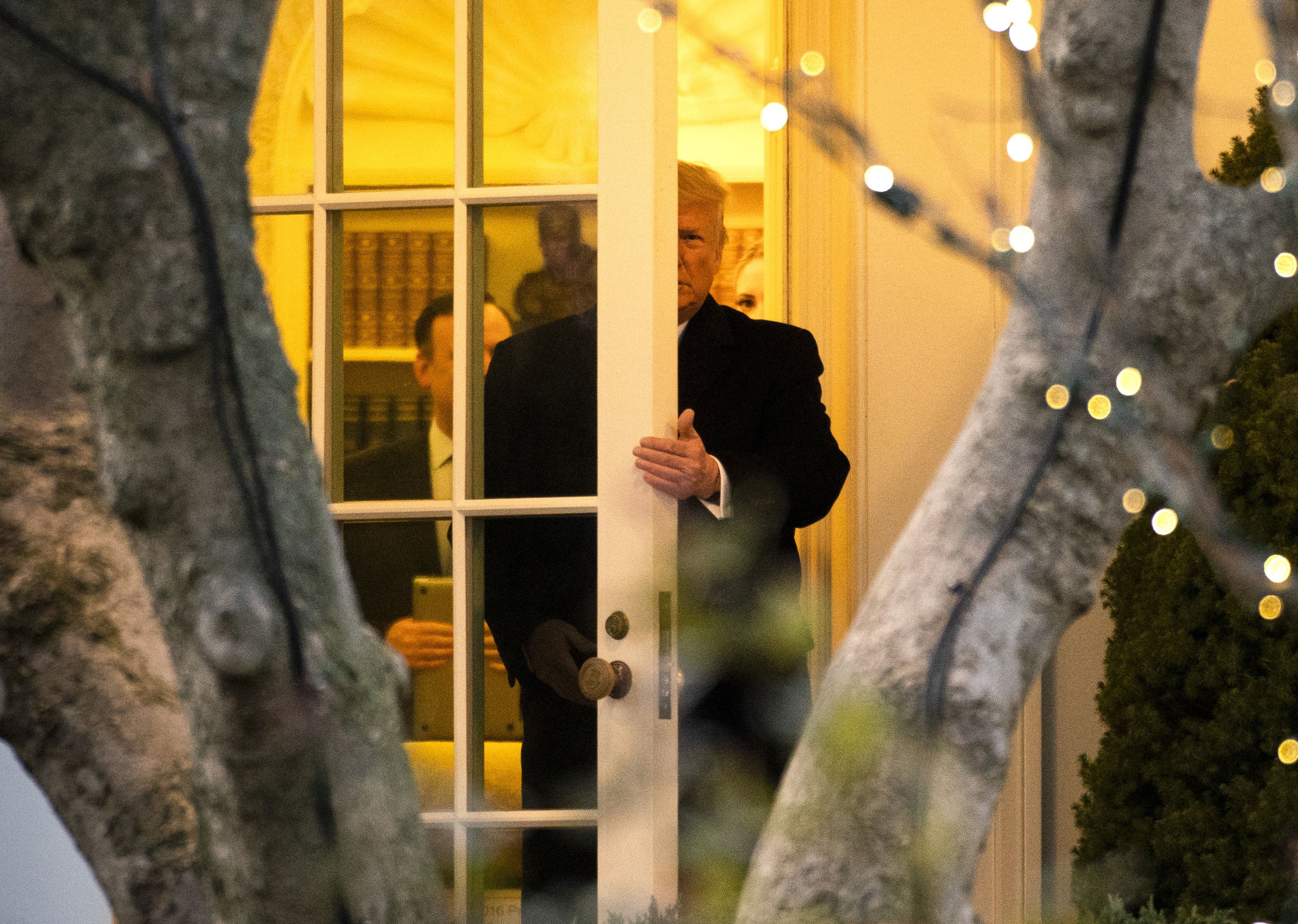 President Donald Trump departs the Oval Office at the White House in Washington on Wednesday evening, December 18, 2019, for a scheduled campaign event in Battle Creek, Michigan.