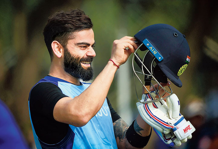 Skipper Virat Kohli enjoys a light moment during practice in Hyderabad on Thursday