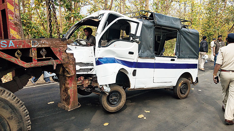 The school van being towed away from the accident spot near Durgapur.