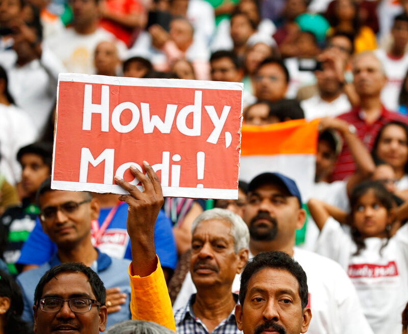 People look on as President Donald Trump arrives to speak at the 'Howdy Modi: Shared Dreams, Bright Futures' event with Prime Minister Narendra Modi at NRG Stadium on Sunday in Houston.