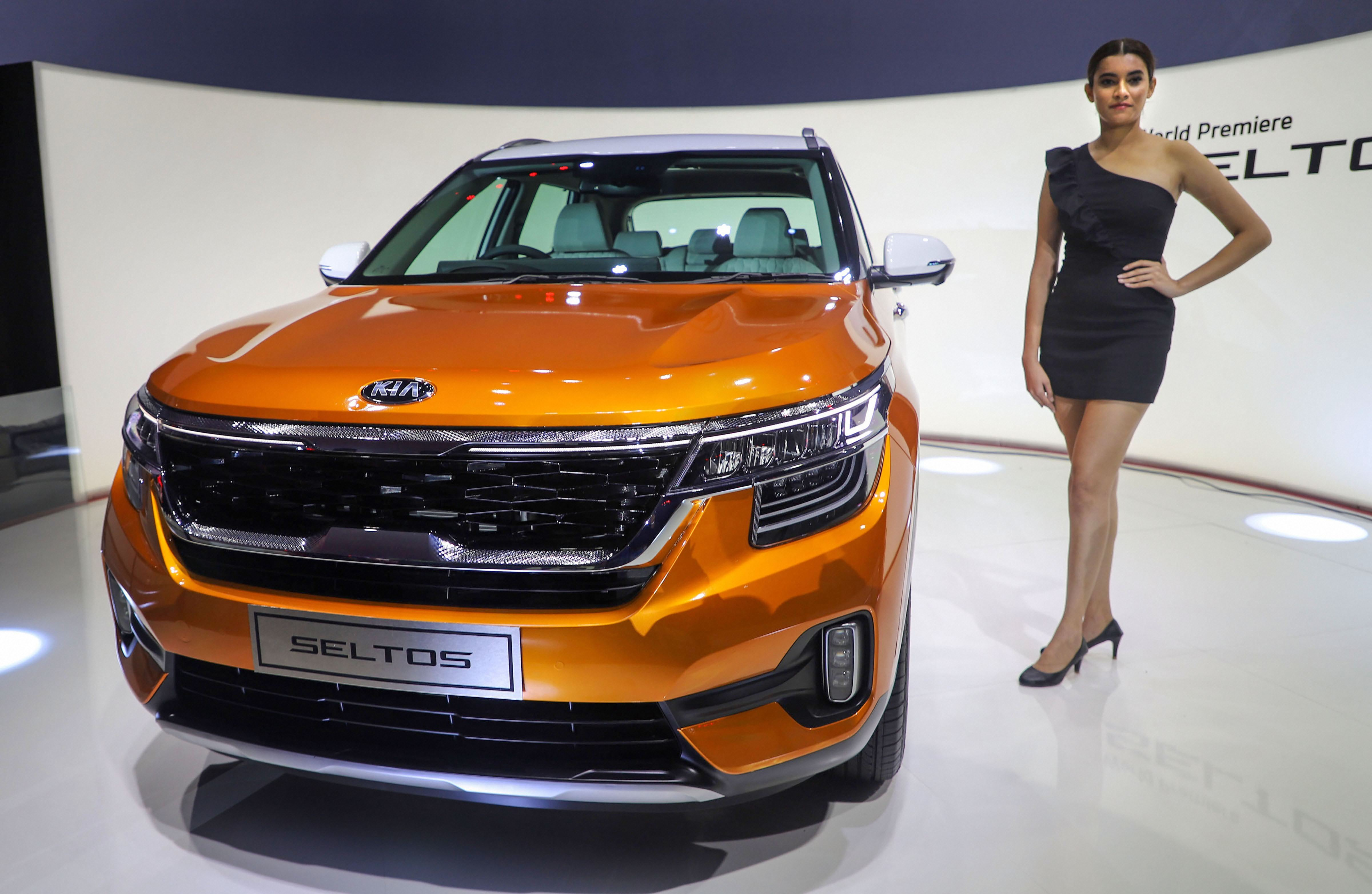 A model poses next to the newly launched Kia Seltos in Gurgaon.