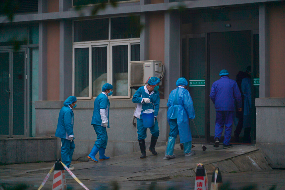 Health officials in Wuhan, China. The coronavirus has killed 81 in the country