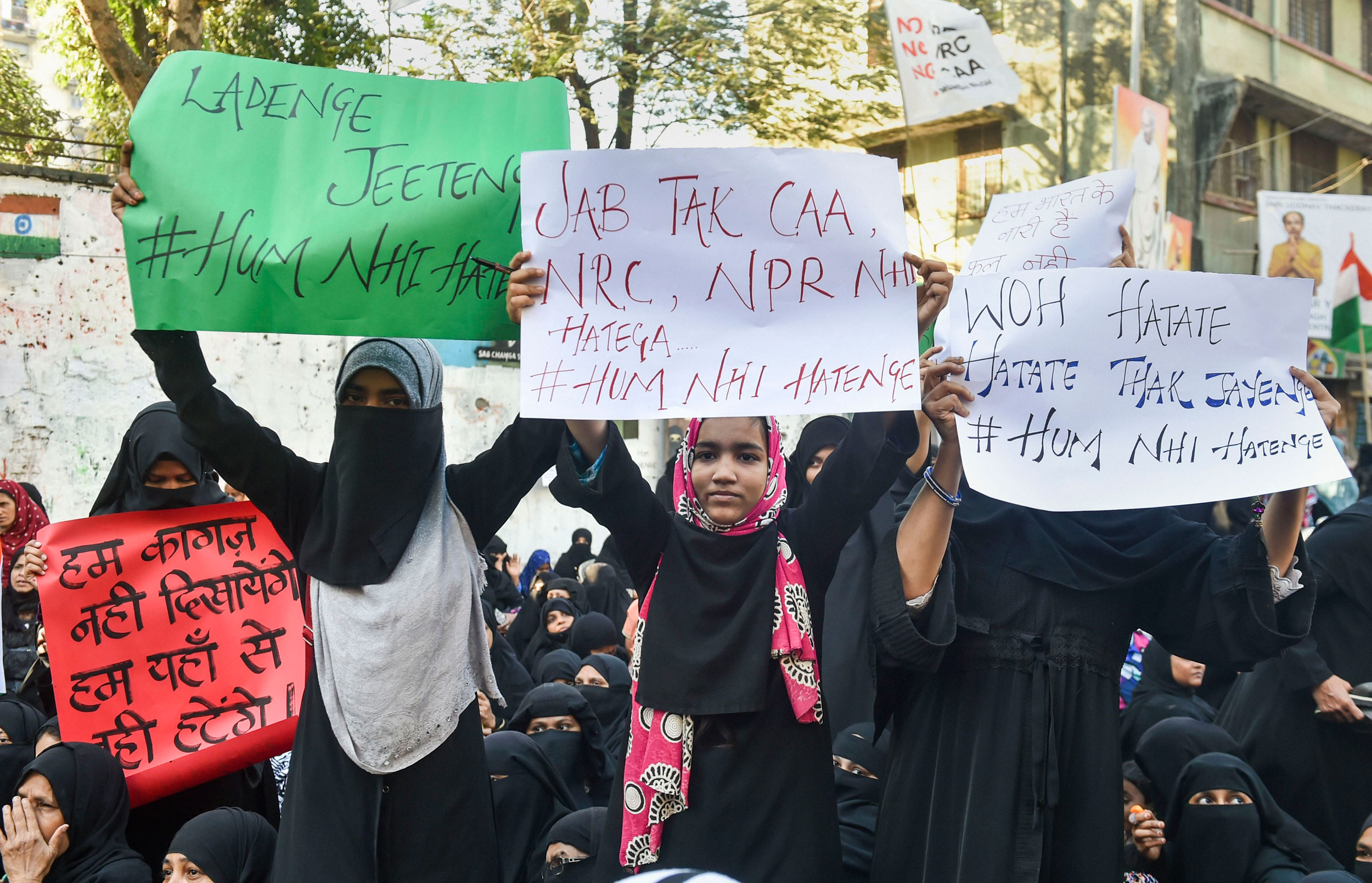 Women hold placards during a protest against CAA and NRC in Mumbai on Thursday.