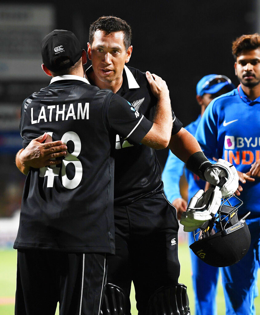 Ross Taylor hugs his captain Tom Latham at the end of the One Day cricket international between India and New Zealand at Seddon Oval in Hamilton on Wednesday